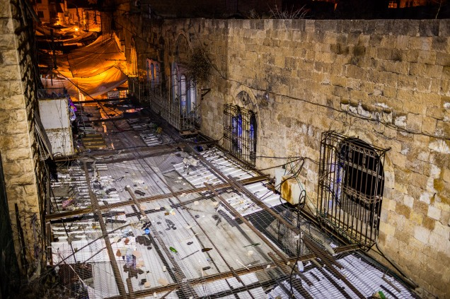 Metal grids installed in the Old City to prevent garbage dropped by Israeli settlers falling into a Palestinian area. Hebron, 2013.