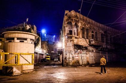 Old city with Israeli bunker. Hebron, 2013.