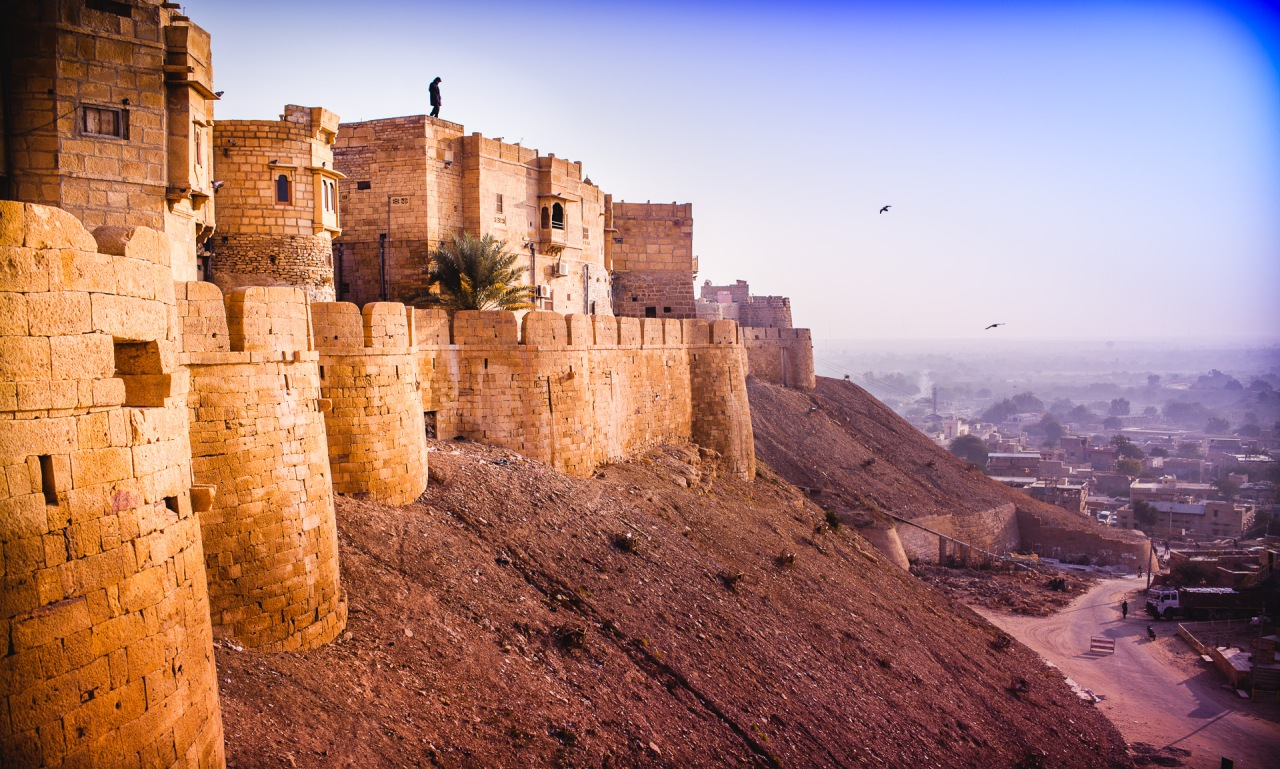 On the edge of a city made of Gold. I was there looking at the man on the top of the fort, but maybe I am this man looking over the birds. Or maybe I am the birds. Jaisalmer, India, 2014.