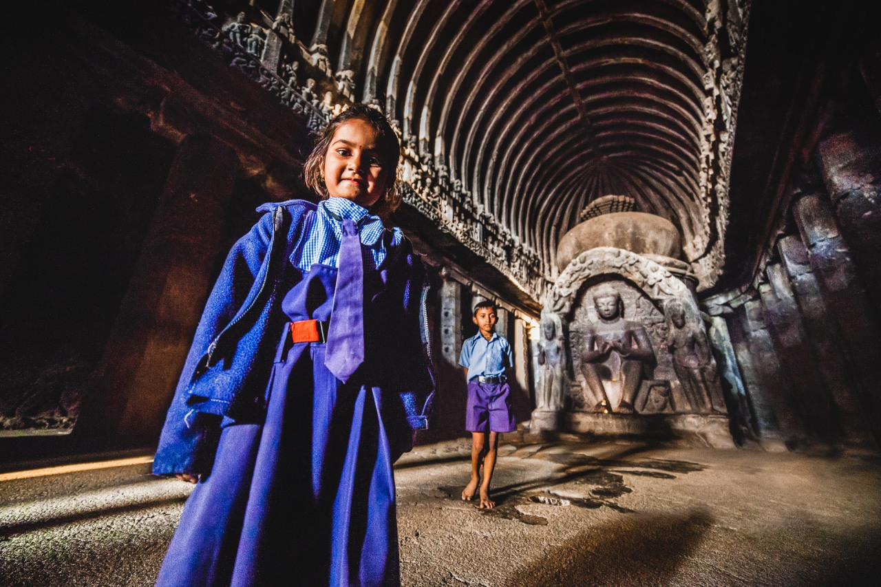 Back to school. I was setting up my tripod and checking my focus when those two subject decided my camera was certainly more interesting than the more than 1300 years old carved cave and statues around. I pulled the focus a bit closer, then triggered. Ellora Caves. Maharashtra, India, 2014.