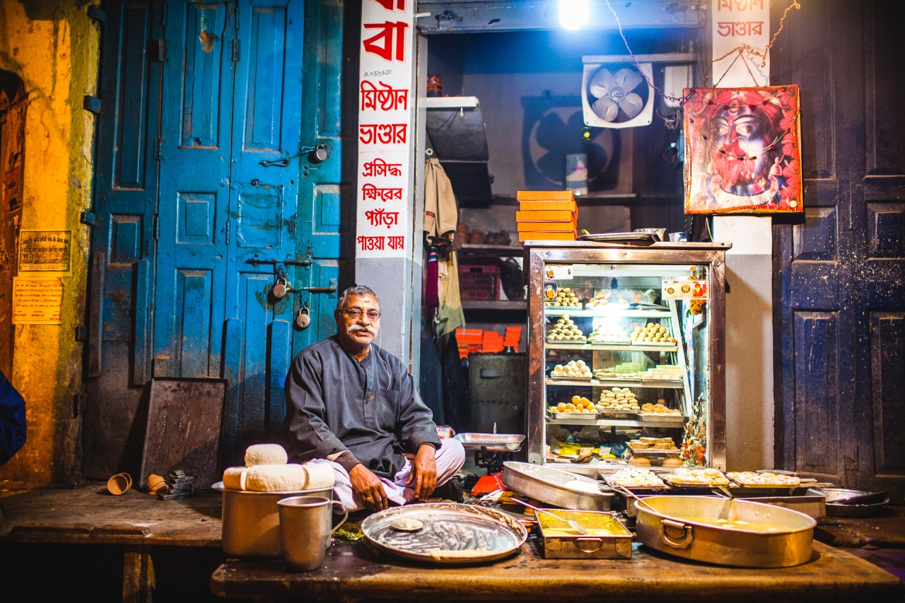 Indian Starbucks. It's all about sugar and some 1000 ways to cook it, with the billion flavours and spices they master. Almost open 24/7 or when the goods are ready. Varanasi, Uttar Pradesh, India, 2014.