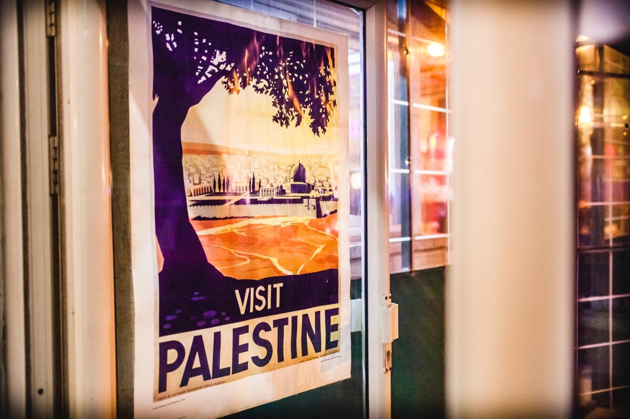 Visit Palestine, a sign in a café in Jerusalem. Jerusalem, Israel, 2014.