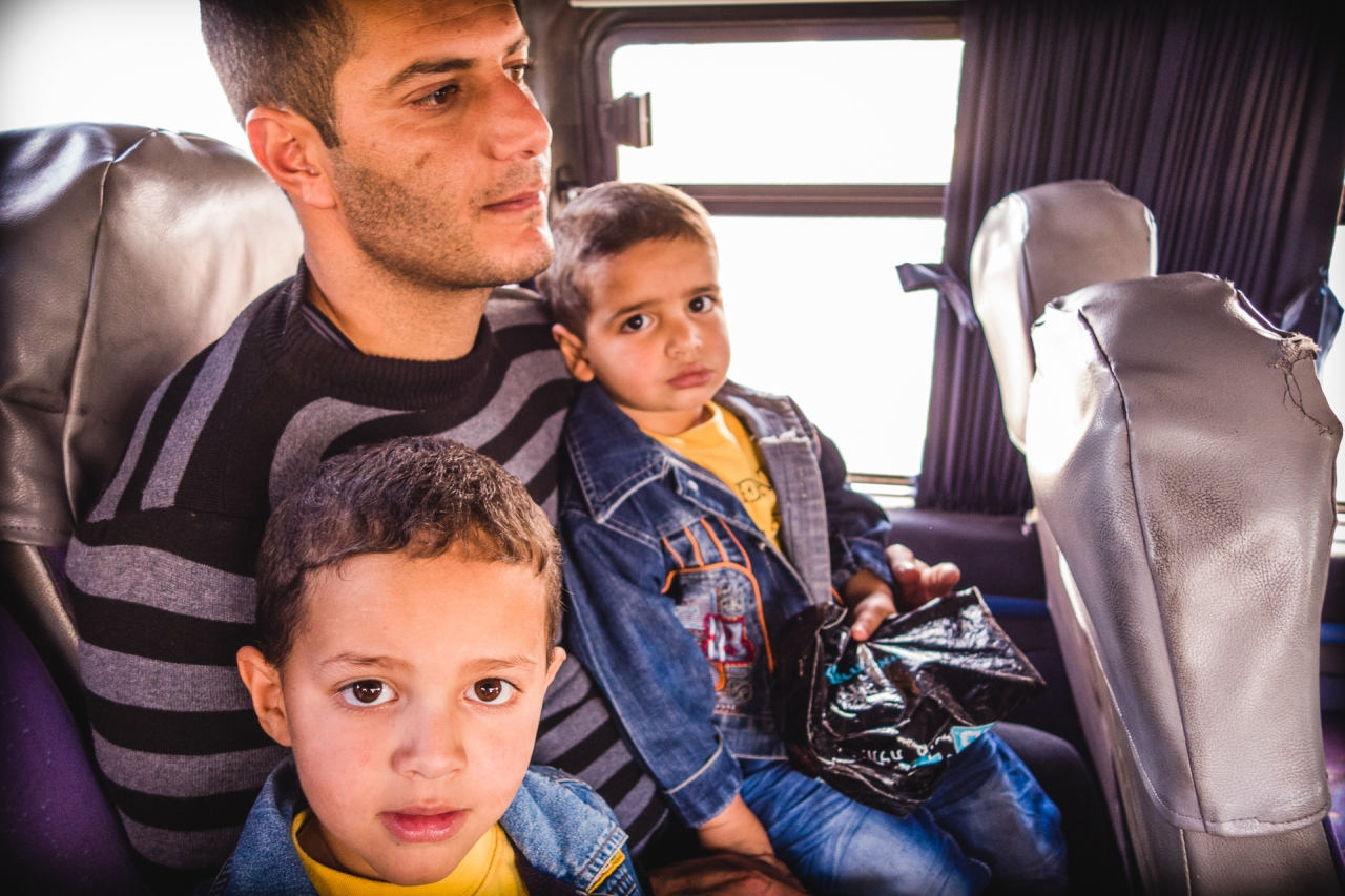A father with his two sons in the bus to Bethlehem. Bethlehem, Palestine, 2014.