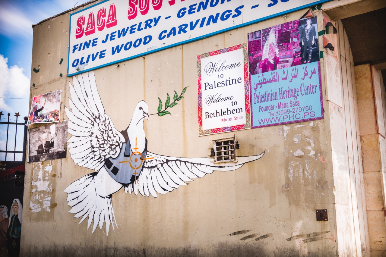 Welcome in Bethlehem with a Banksy tag. Bethlehem, Palestine, 2014.