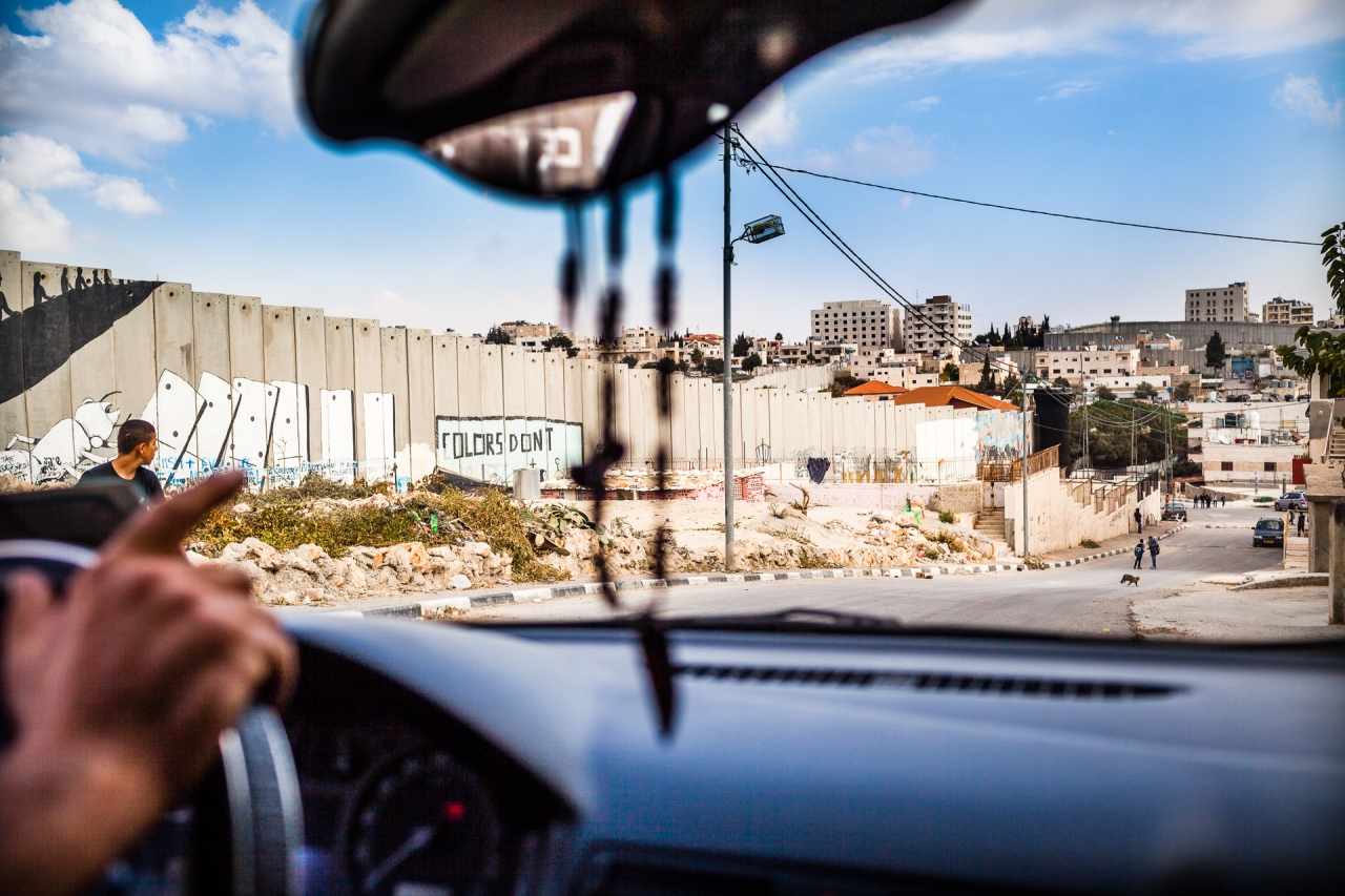 Driving around the Segregation Wall. Bethlehem, Palestine, 2014.