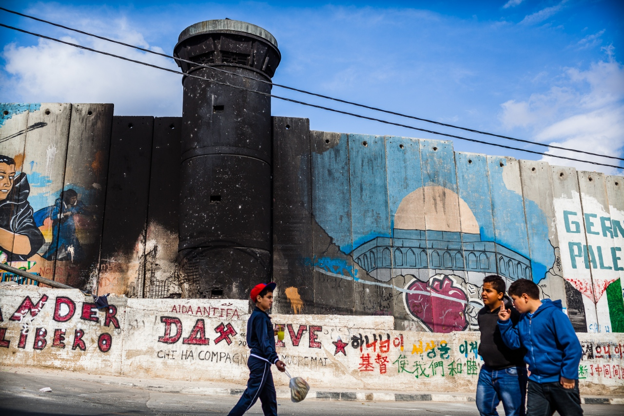 Life scene along the Segregation Wall. Bethlehem, Palestine, 2014.