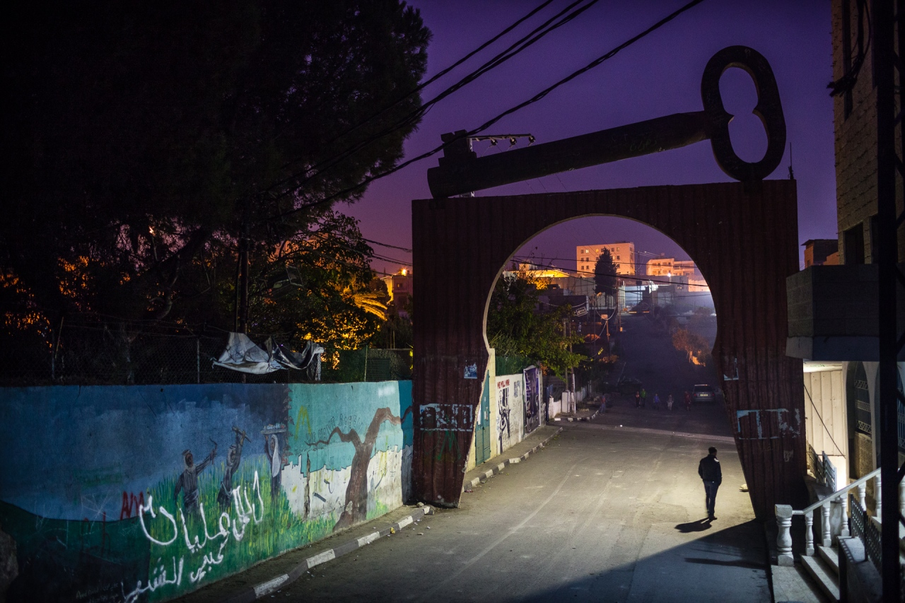 The door of the Aida Camp, in the background, a door entrance to Israel on Segregation Wall. Bethlehem, Palestine, 2014.