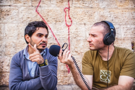 Photographs by David Feuillatre, here interviewing a Palestinian media worker at the Damascus gate in Jerusalem. Jerusalem, Israel, 2014.