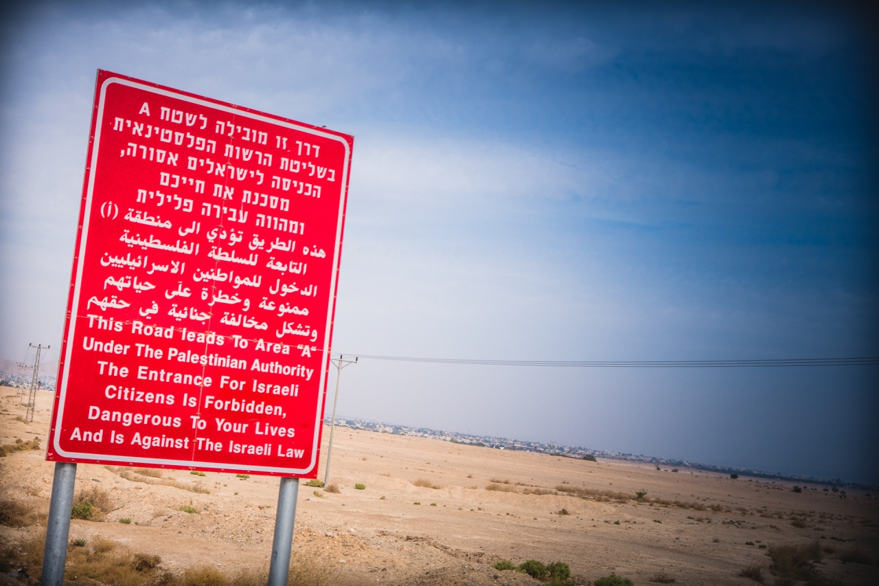 A road sign along the palestinian roads. Jericho, Palestine, 2014.