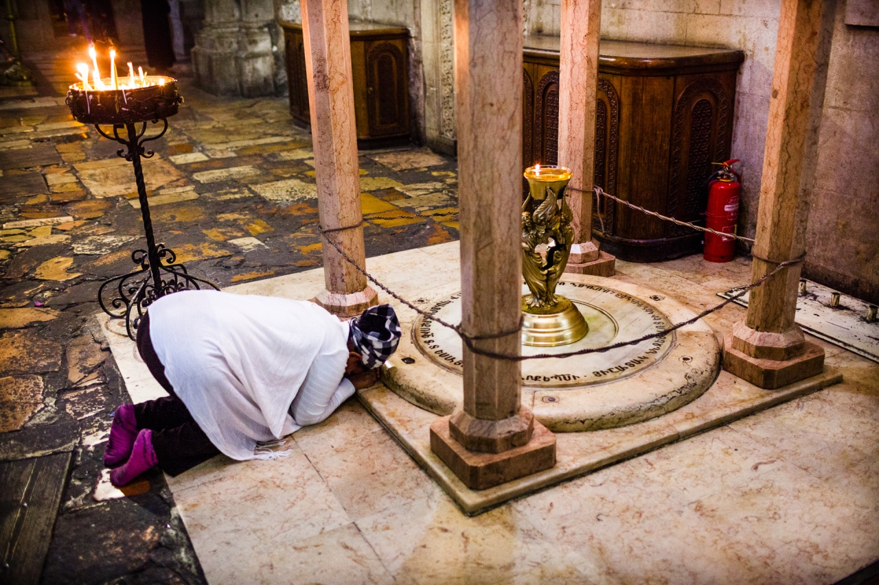 Scene of devotion in the Church of the Holy Sepulchre. Jerusalem, Israel, 2014.